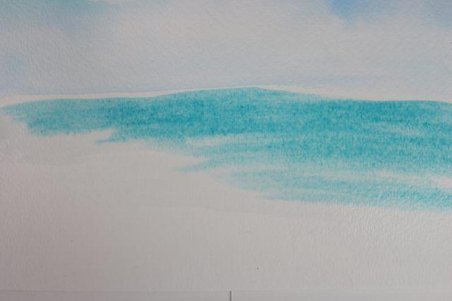 Escova em Ultramarine enquanto o papel ainda está molhado.