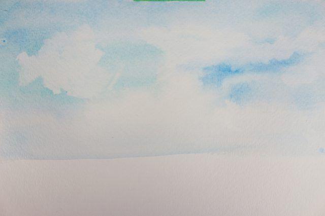A forma irregular do papel toalha forma nuvens quando a tinta é absorvida.
